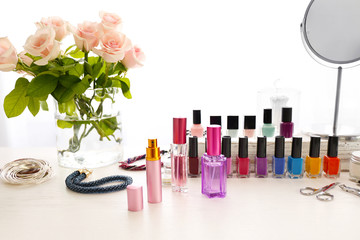Perfume and nail set on light dressing table
