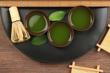 Green matcha tea set on wooden table, top view