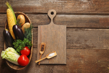 Set of vegetables and spices on wooden background