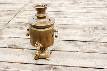 brass samovar on a wooden table