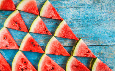 on a blue background flat triangles of watermelon