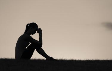 Desperate and sad woman sitting alone.