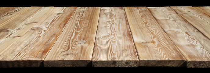 Image of empty wooden table top isolated on black