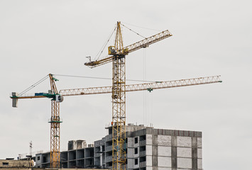 crane on construction of the house on a background of the daytim