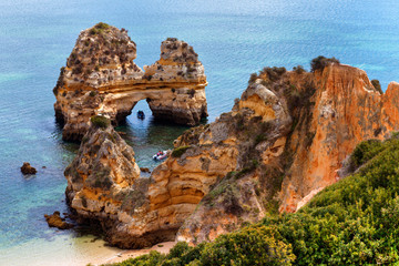 Wall Mural - Arch of cliffs on Praia do Camilo beach, Algarve, Portugal