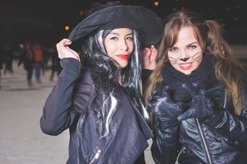 Halloween party! Young women like witch and cat role
