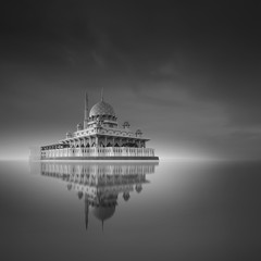 Putra Mosque, Putrajaya Malaysia in monochrome long exposure fine art reflection on the lake surface with grain effect.