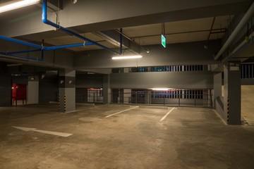 Car parking garage interior warm lights in dark