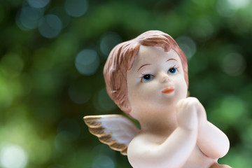 Angelic cupid statue