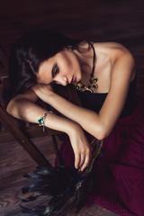 sensual woman lying on chair