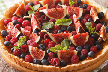 Freshly baked cake with fresh figs, raspberries and blueberries macro. horizontal