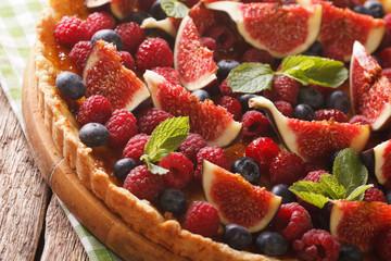 tart with figs, raspberries and blueberries macro. horizontal