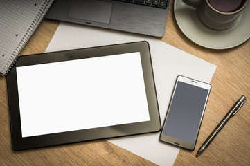 Digital tablet on business table with blank white screen
