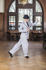 Portrait Of Confident Male Dancer Performing Tango
