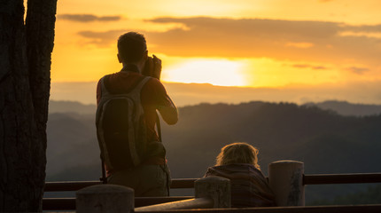 Couple Watching Sunset Mountain Outdoors Concept