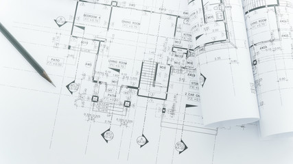 architects workplace - architectural blueprints with measuring tape, safety helmet and tools on table. top view