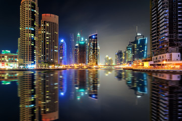 Amazing night dubai marina skyline with tallest skyscrapers and beautiful water reflection, Dubai, United Arab Emirates