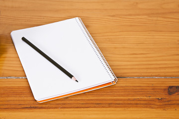 notepad with pen on wooden table