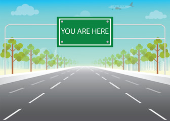 Road sign with you are here words on highway. Wall mural