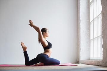 Woman doing exercise on yoga mat.