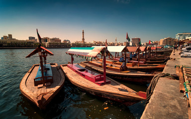 Traditional Abra taxi boats in Dubai creek - Deira during sunny day, Dubai Deira, United Arab Emirates