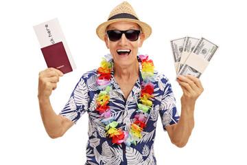 Elderly tourist holding stacks of money