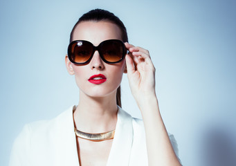 Female fashion model wearing sunglasses.