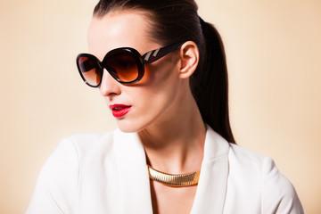 Female fashion portrait wearing sunglasses.