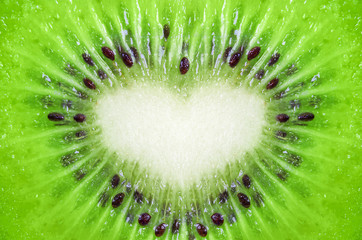 Close up of kiwi fruit texture background with heart shape