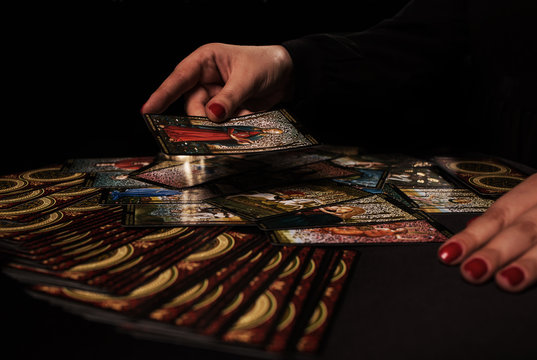 Witch ritual with cards dark
