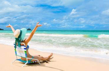 Happy woman on a tropical beach.