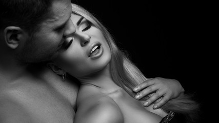 Passionate woman and man in studio