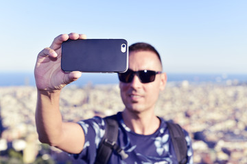 man taking a selfie in Barcelona, Spain