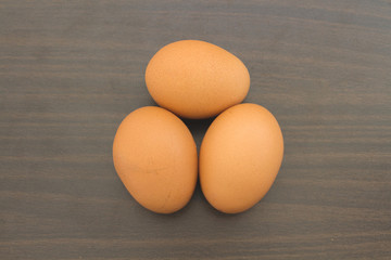 Eggs On Wooden / Freshness Of The Three Eggs For Cooking On Wooden Background.