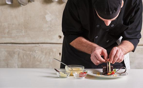 Restaurant hotel private chef preparing desert chocolate cake