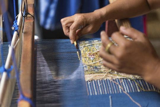 Girl weaving thai style sarong in Thailand