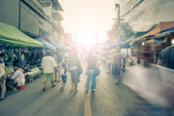 Blurred image of street market with retro color effected, blurre