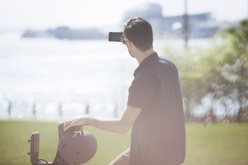 Man photographing through smartphone while sitting on Citi Bike