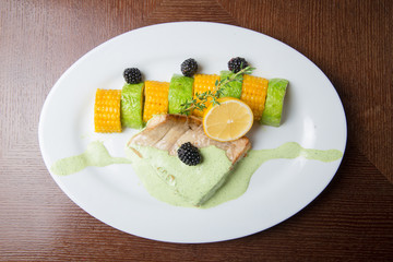 Grilled fish steak with Citrus, lime and corn