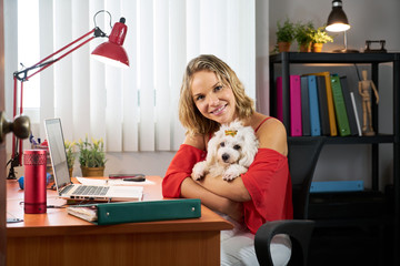 Portrait Business Woman Working With Pet Dog In Office