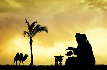 Moroccan men drinking tea at sunset