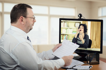 Woman takes pill under virtual supervising