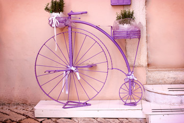Rustic - vintage, outmoded purple bicycle (lavender colored bike)
