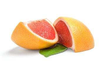 Two wedges of grapefruit on white background
