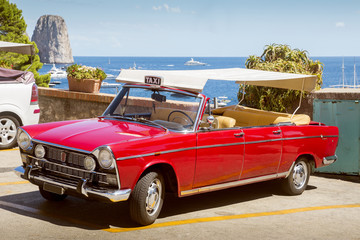 Vintage convertible taxi car on Capri island in Italy