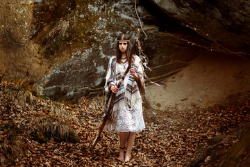 beautiful native indian american woman holding pikestaff with dr