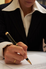 business woman sign document
