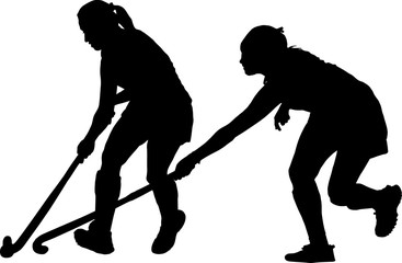 Silhouette of girl ladies hockey players battling for possession