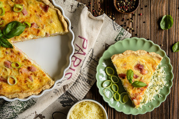 Traditional French Quiche Lorraine with Cheddar, Camembert, bacon and eggs