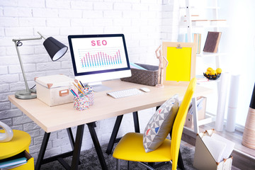 SEO technology concept. Modern workplace interior.